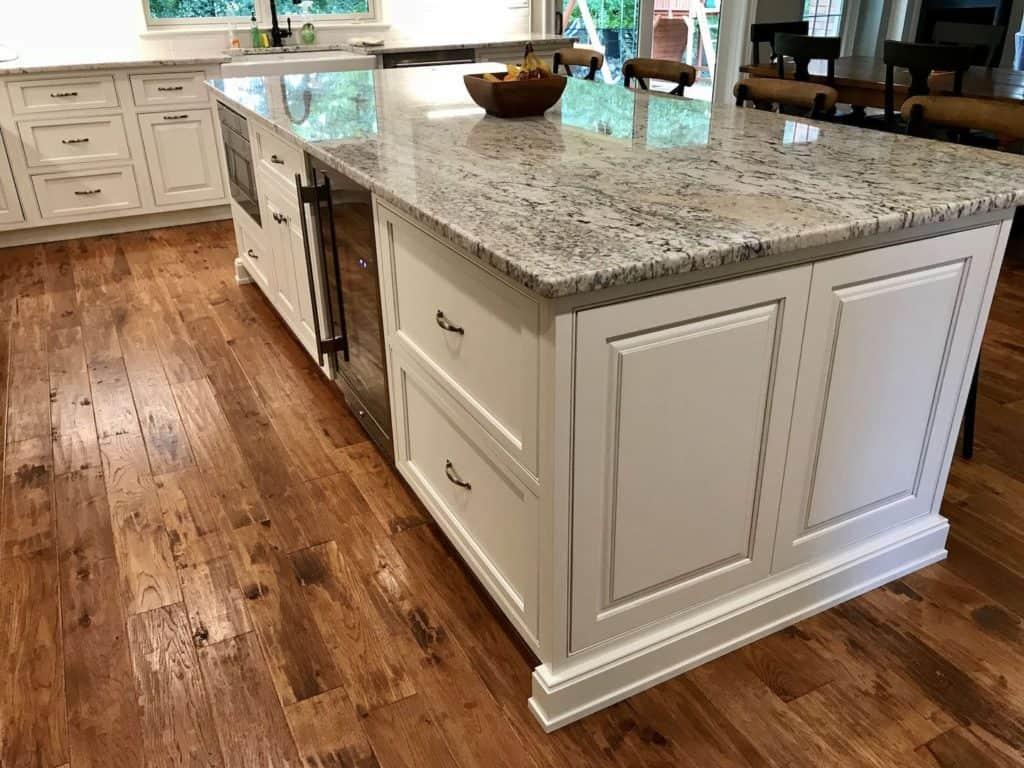 grey granite countertop color and wood flooring