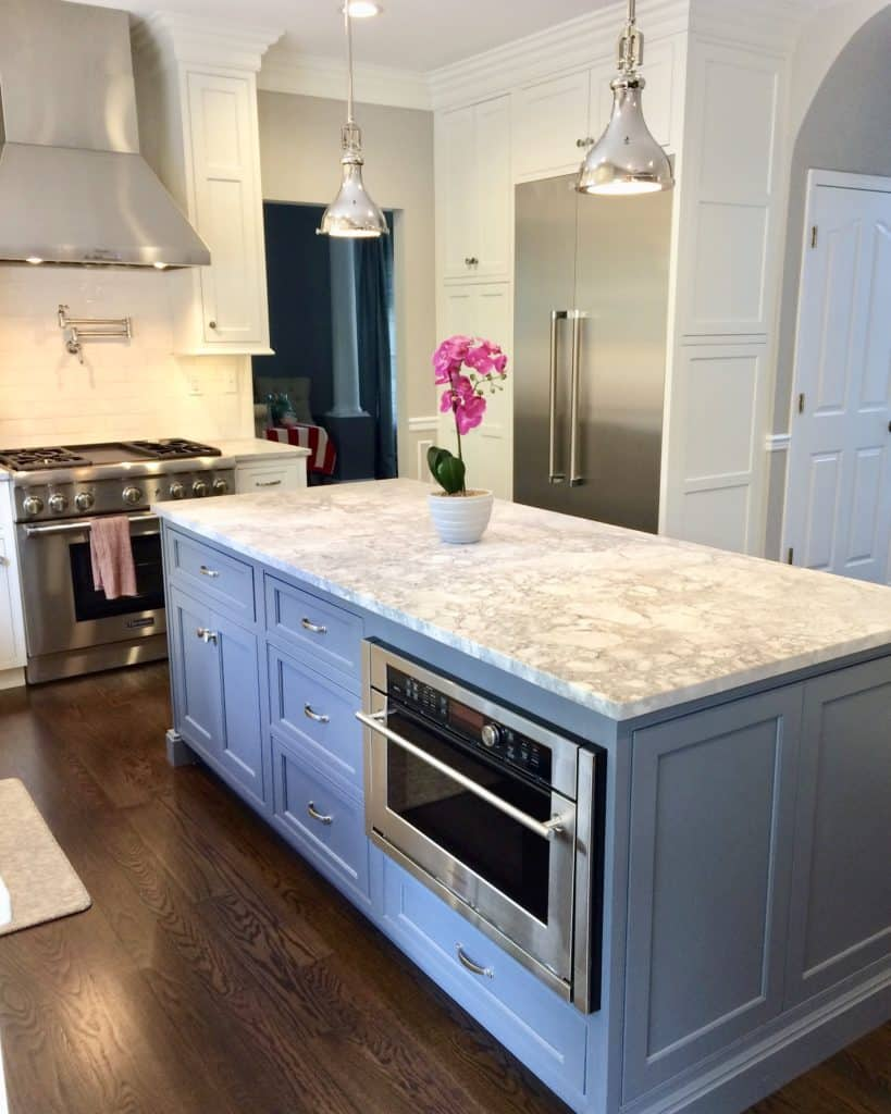 granite countertop with light blue cabinets