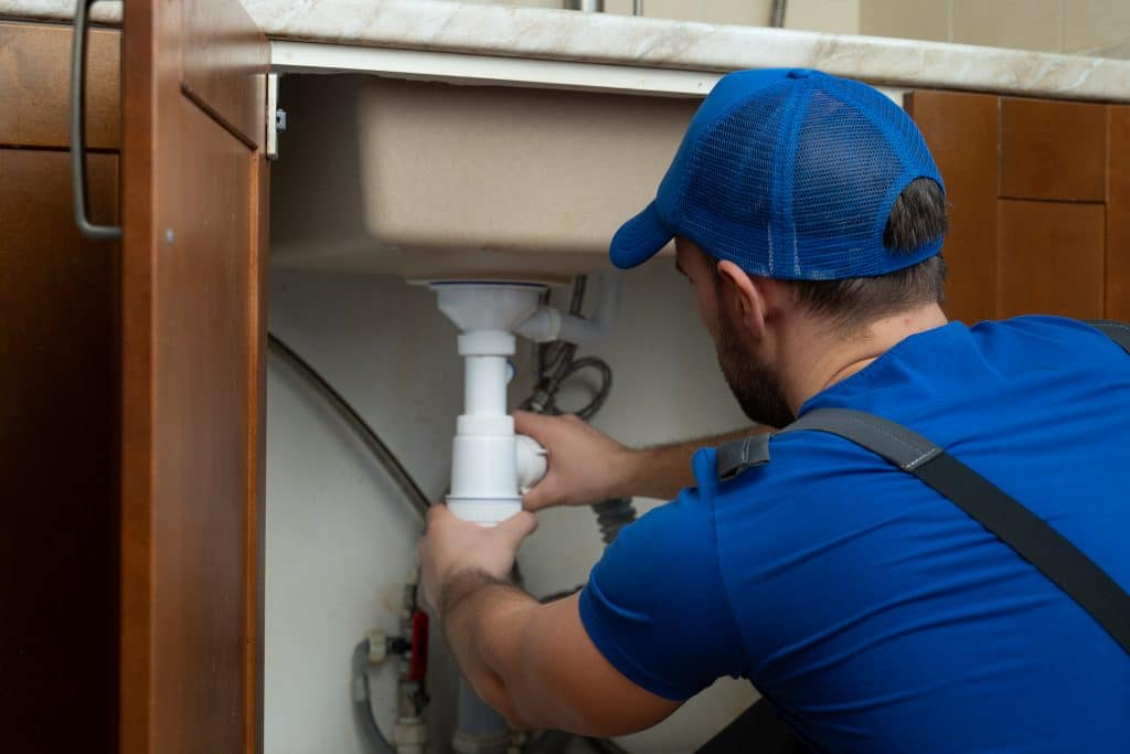 Checking for leaky kitchen pipes