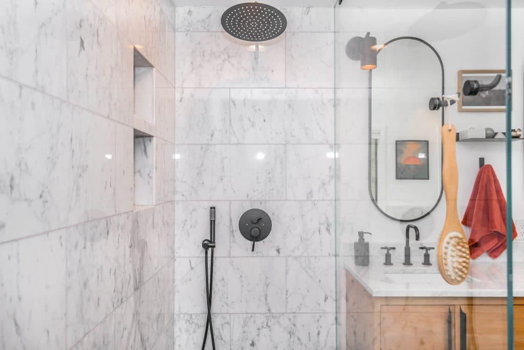 black shower head on white ceramics
