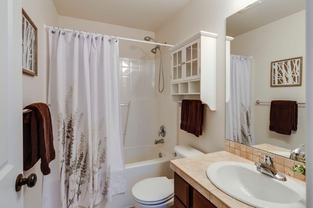 A straight shower curtain rod